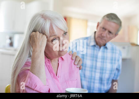 Mature Man Comforting Woman With Depression At Home - Stock Photo
