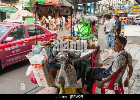Street food on the Khaosan road in the Banglamphu district of Bangkok, Thailand. - Stock Photo