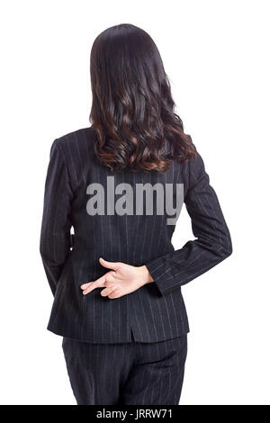 young asian business woman hiding a good luck hand sign behind back, isolated on white background. - Stock Photo