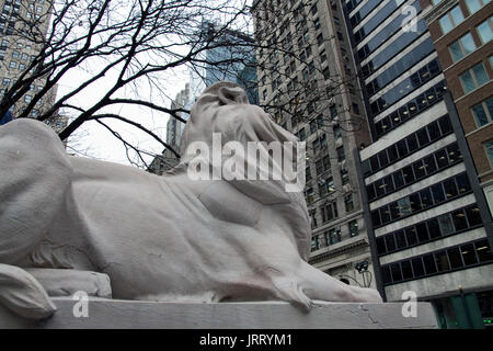 Lion statue at the entrance to New York Public Library in Manhattan, NY. - Stock Photo