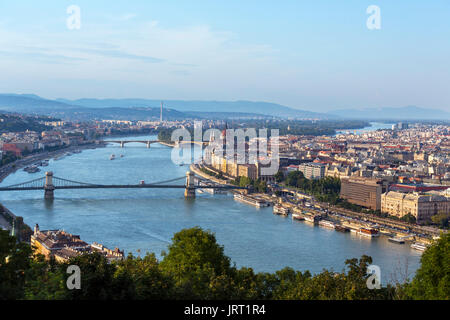 View from Gellert hill over the Danube towards Pest and the Parliament building with the Chain Bridge crossing the - Stock Photo
