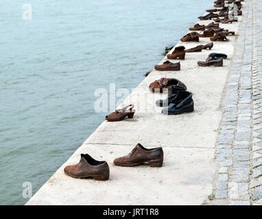 'Shoes on the Danube Bank' sculpture, a 2005 memorial to people killed by fascists in WWII,  Budapest, Hungary - Stock Photo