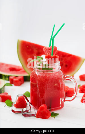 Fresh watermelon smoothies with mint on white wooden background. - Stock Photo