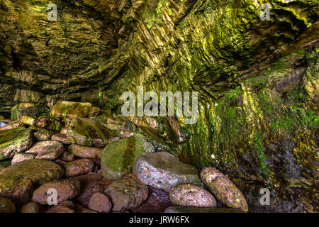 Inside a moist cave in La Jolla California. The beautiful rock cave at the sea from the inside of the cave at mid - Stock Photo