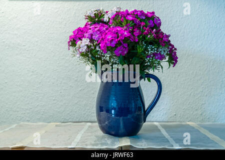 Still Life with peasant carnations bouquet. - Stock Photo