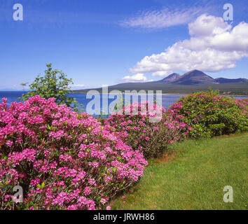 A beautiful summer view towards the Paps of Jura from across the Sound of Islay at Caol Ila on Islay, Argyll - Stock Photo