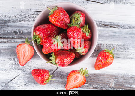 strawberries on wooden background fresh and ripe - Stock Photo