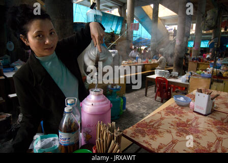 Food market, stand serving food. Sapa region, North Vietnam. Asia. Ethnic Hmong tribe, shopping at Muong Hum market, - Stock Photo