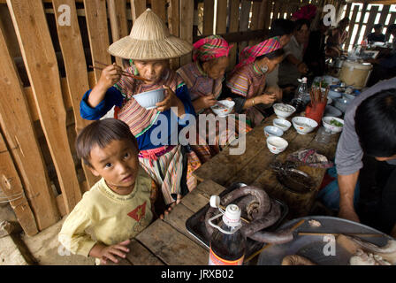 Bac Ha sunday market restaurant. Flower Hmong people in traditional dress at weekly market, Sapa, Vietnam. Young - Stock Photo