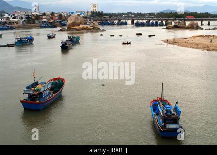 Fishing boats on Cai River, Nha Trang City, Vietnam, Indochina, Southeast Asia, Asia. Tran Phu bridge. - Stock Photo