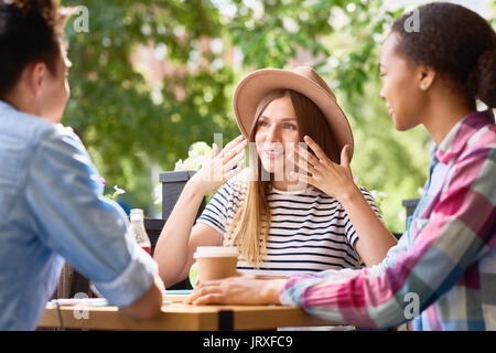 Young Friends at Lunch in Cafe - Stock Photo