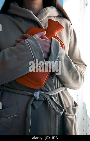 Young woman with a bag of hot water - Stock Photo