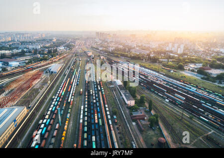 Cargo trains. Aerial view of colorful freight trains. Railway station. Wagons with goods on railroad. Heavy industry. - Stock Photo