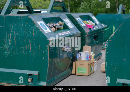 Green recycling containers full with paper and boxes at an environmental station in Soderhamn, Sweden - July 18 - Stock Photo