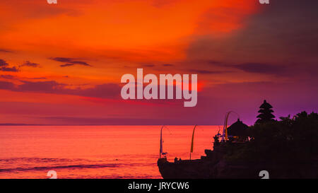 Scenic landscape of high cliff and tropical sea at Uluwatu Temple, Bali, Indonesia. Amazing sunset at Uluwatu temple - Stock Photo