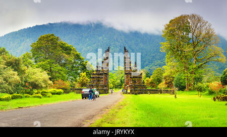 Traditional Hindu gate at rainy day - Candi Bentar, Bedugul in Bali, Indonesia. Hindu gate in Bedugul, Bali, Indonesia. - Stock Photo