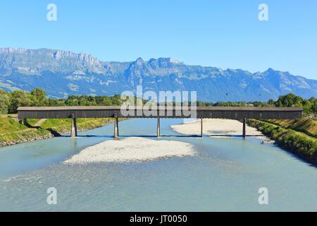 The Old bridge (1901) over the Rhine in Vaduz, Liechtenstein - Stock Photo