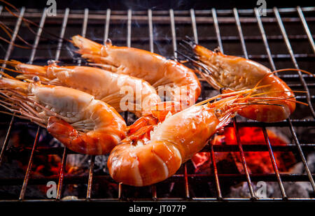 shrimp ,prawns grilled on barbecue fire stove - Stock Photo