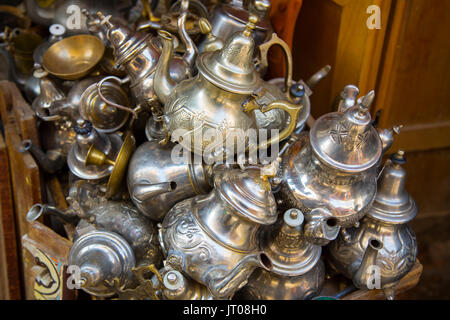 Traditional metal Moroccan mint teapot for sale in the souk, old Souk Medina of Fez. Fes el Bali. Morocco, Maghreb - Stock Photo