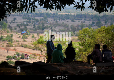 Laotian people sitting and relax after visit Vat Phou or Wat Phu in UNESCO World Heritage Site on May 1, 2015 in - Stock Photo
