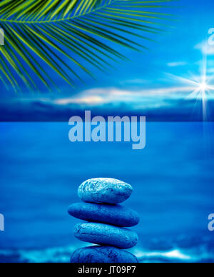 close up shot of stone pile over sea and morning sky. - Stock Photo