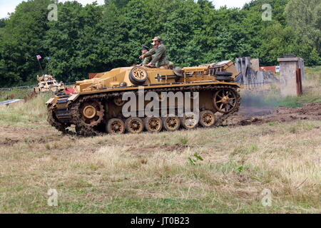 A second world war German tracked vehicle lovingly restored to its former glory and being run around an arena on - Stock Photo