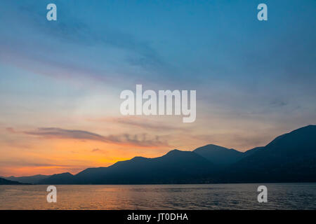 Picturesque foggy sunset at Iseo lake, Lombardy, Italy - Stock Photo