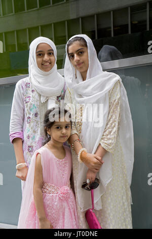 Pakistani sisters wearing hijabs at the annual Pakistan Day Parade ion Midown Manhattan, New York City. - Stock Photo