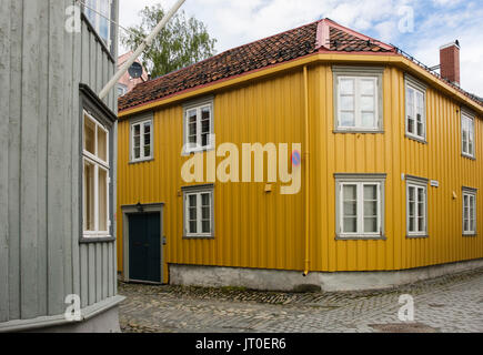 Traditional wooden house with angled corner on a narrow cobbled street in old town district. Trondheim, Sør-Trøndelag, - Stock Photo