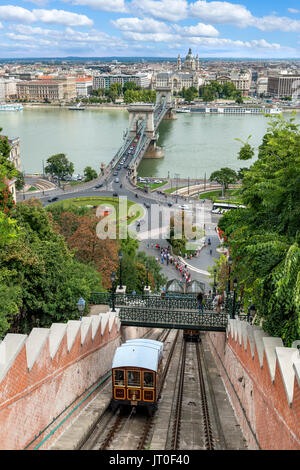 The Siklo funicular from the top of Castle Hill looking over the Danube to the Chain Bridge and Pest, Buda, Budapest,Hungary - Stock Photo