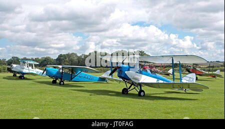 de Havilland Moths, Tiger Moths, and a solitary Puss Moth on the flight line at the 2017 Annual Moth Meet at the - Stock Photo