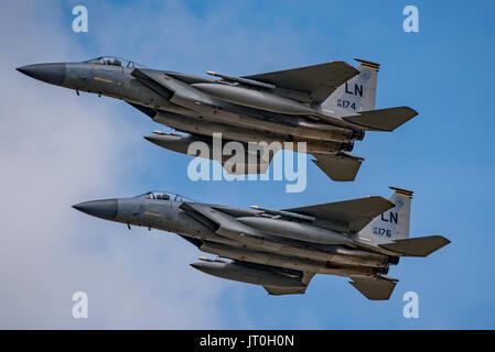 F-15C Eagle pair participating in the United States Air Force 70th Anniversary Flypast at the Royal International - Stock Photo