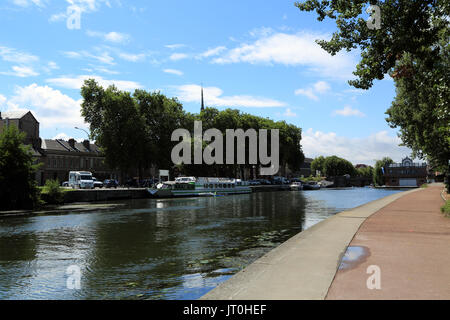 River Somme from footpath at Chemin de Halage, with Cathedral notre dame in the background at Amiens, Somme, Hauts - Stock Photo