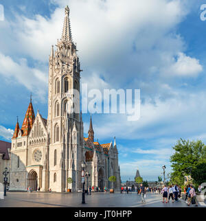 Matthias Church with Fishermen's Bastion behind, Buda Castle district, Castle Hill, Budapest, Hungary - Stock Photo