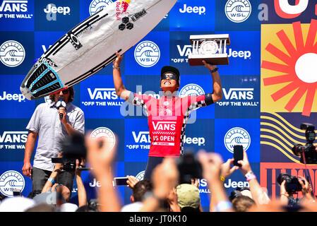 Huntington Beach, USA. 06 August, 2017. Kanoa Igarashi (USA) hoists the trophy as he's crowned the 2017 VANS US - Stock Photo