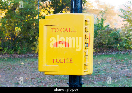 emergency call police yellow box in a New-York city park - Stock Photo
