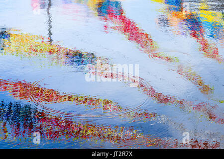Colorful stripes reflections, ripple water surface. Abstract background photo - Stock Photo