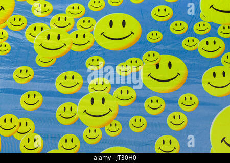 Smiling face emojis on fabric - Stock Photo