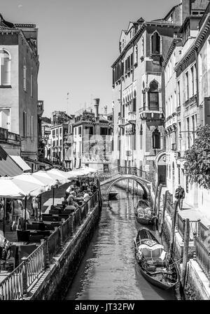 Gondola ride through the beautiful canals in Venice - VENICE, ITALY - JUNE 29, 2016 - Stock Photo