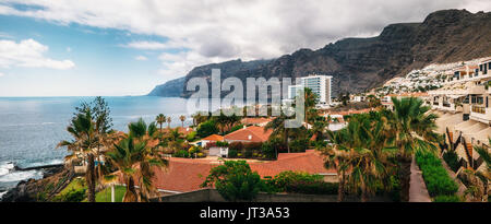 Panoramic aerial view of the Los Gigantes cliffs on Tenerife. The picturesque and serene resort. Canary islands, - Stock Photo