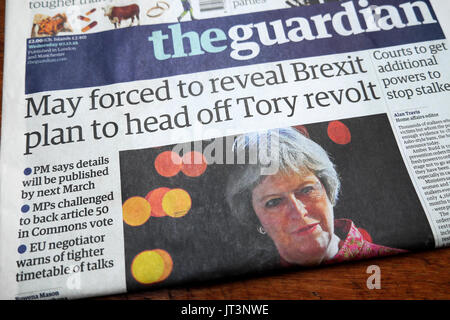 Guardian newspaper headline 'May forced to reveal Brexit plan to head off Tory revolt'  7th December 2016 - Stock Photo