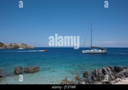 Sailboat sailing in the waters outside Agios Nikolaos, on the island of Zakynthos in Greece - Stock Photo