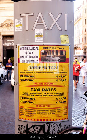 Rome Italy July 2017 - Taxi tariffe prices tarif in Rome with sign saying Uber taxis are illegal in Italy - Stock Photo