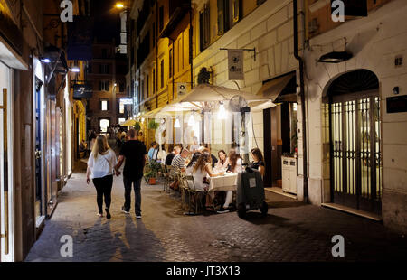 Rome Italy July 2017 - Eating out in one of the many narrow streets in the Tridente district - Stock Photo