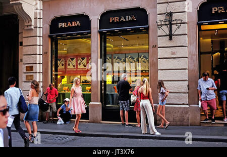 Rome Italy July 2017 - Shoppers pass by the famous Prada store in Tridente - Stock Photo