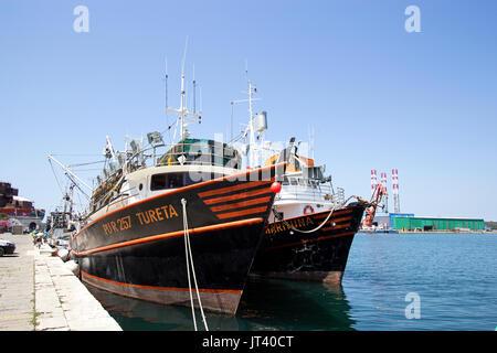 Fishing boats along the quay side, Pula Croatia - Stock Photo