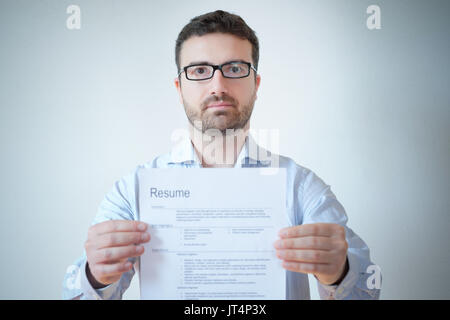 Man with resume and work career ready to find a job - Stock Photo