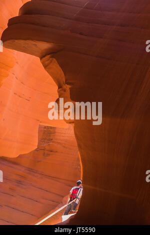 Tourist in Antelope Canyon, Arizona, USA - Stock Photo