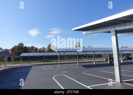 HOUSTON, USA - JANUARY 12, 2017: Some cars parked, with a solar panel protecting from the sun the cars in Legoland - Stock Photo