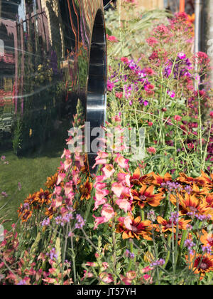 Pip Probert show garden 'For the Love of it' at the 2017 RHS Tattoo Flower Show.  Reflections in the David Harper - Stock Photo